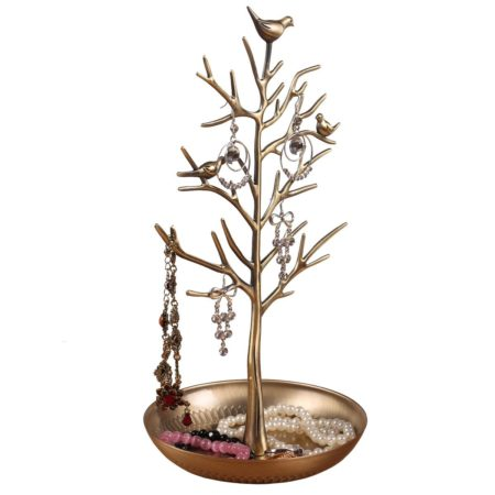 metal tree with a bird on top that serves as a jewelry stand