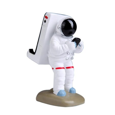 astronaut in space suit texting while holding your phone as a smartphone stand