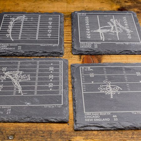 slate coasters commemorating pro football teams greatest plays