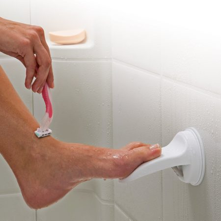 easy install suction cup foot rest for shower to make shaving legs easier and safer