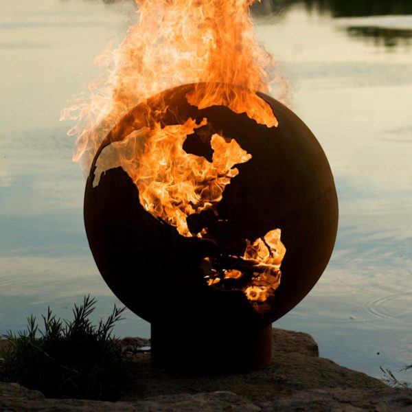 Large metal fire pit in shape of world globe
