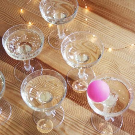 beer pong but with prosecco glasses and a pink ping pong ball