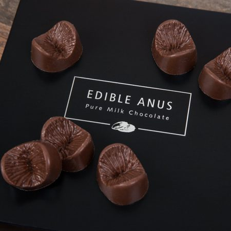 chocolate gift box with chocolates in the shape of an anus