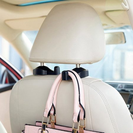 car seat headrest hooks that allow you to hang bags from them, creating extra floor space so you can transport more bags