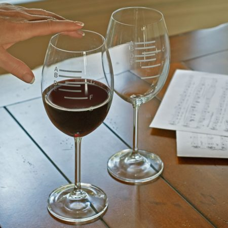 wine glasses with level markings for different musical notes