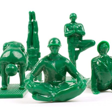 green miniature plastic army soldiers in yoga poses